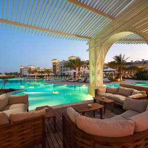 BARON PALACE SAHL HASHEESH Infnity Pool Bar by Sunset